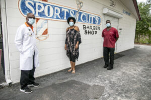 From left, Dr. Fredrick Guerrier, Faye Watson and Milt Mobley met at Mobley's Sports Cut Barber Shop on 18th Ave. South in St. Petersburg to discuss and demonstrate best practices for handling hair clients safely during the COVID-19 pandemic.  Photo by Boyzell Hosey